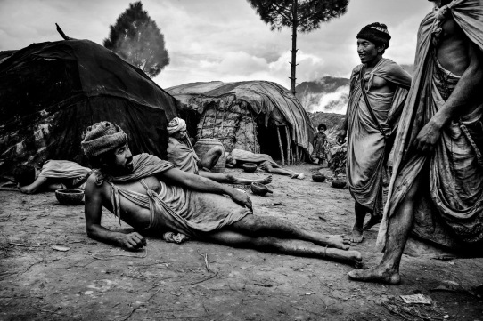 Prakash Shahi (left) with his friends in a temporary Raute settlement in Salyan district of Nepal.
